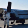 Military space plane lands after secret mission
